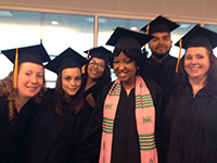 Group of BSN students in caps and gowns