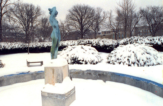 Statue of Eve in the snow.