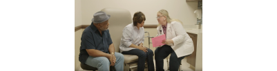Nurse consulting with two patients