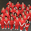 Group of students in red scrubs